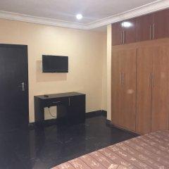 Отель Grand Riviera Suites Энугу удобства в номере фото 2