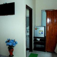 Отель Milk Fruit Homestay сейф в номере