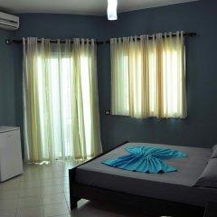 Отель Villa Qendra Албания, Ксамил - отзывы, цены и фото номеров - забронировать отель Villa Qendra онлайн комната для гостей фото 2