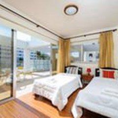 Апартаменты Mike & Lenos Tsoukkas Seaview Apartments комната для гостей фото 4