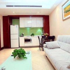 Xuanlong Apartment Hotel комната для гостей