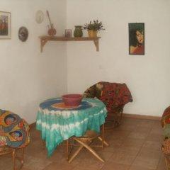 Апартаменты Legassi Gardens Apartments комната для гостей фото 2