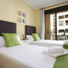 Апартаменты Singular Apartments Candela III комната для гостей