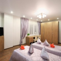 Апартаменты Олимп комната для гостей фото 2