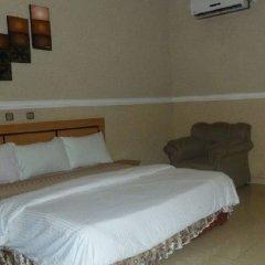 Отель Ritz-Carinton Suites Нигерия, Энугу - отзывы, цены и фото номеров - забронировать отель Ritz-Carinton Suites онлайн комната для гостей фото 3