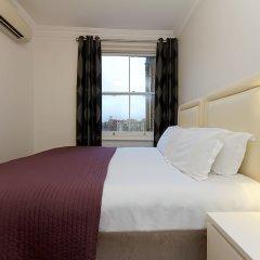Апартаменты Q Kensington Two Apartments комната для гостей