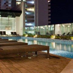 Отель Fiesta Inn Cancun Las Americas Мексика, Канкун - 1 отзыв об отеле, цены и фото номеров - забронировать отель Fiesta Inn Cancun Las Americas онлайн бассейн фото 2