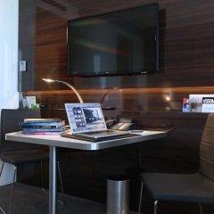 Отель Lindner Congress Hotel Германия, Дюссельдорф - отзывы, цены и фото номеров - забронировать отель Lindner Congress Hotel онлайн удобства в номере фото 2