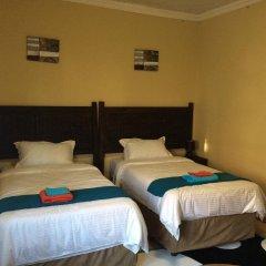 Отель Skyhawk Guesthouse Габороне комната для гостей фото 5