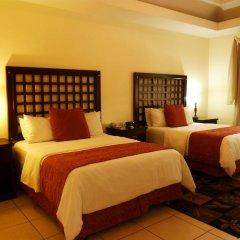 Отель La Casa De Los Arcos Сан-Педро-Сула комната для гостей фото 3