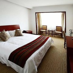 Donghua University Hotel комната для гостей