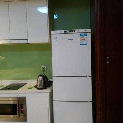 Xuanlong Apartment Hotel в номере