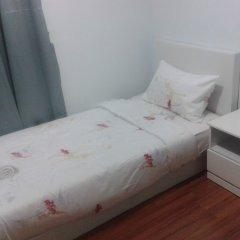 Отель Taragon Apartment Services Малайзия, Куала-Лумпур - отзывы, цены и фото номеров - забронировать отель Taragon Apartment Services онлайн комната для гостей