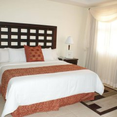 Отель La Casa De Los Arcos Сан-Педро-Сула комната для гостей фото 4