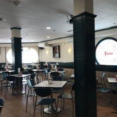 Отель Hostal Cafe Gutgreco питание