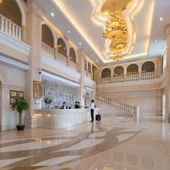 Vienna International Hotel интерьер отеля