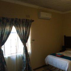 Отель Skyhawk Guesthouse Габороне комната для гостей фото 2