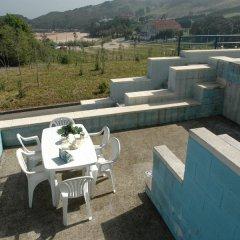 Отель Dúplex Playa La Arena Испания, Арнуэро - отзывы, цены и фото номеров - забронировать отель Dúplex Playa La Arena онлайн бассейн фото 3