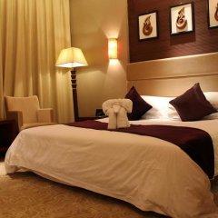 Suzhou YangCheng Garden Hotel комната для гостей