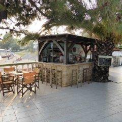 Отель Olympic Bibis Hotel Греция, Метаморфоси - отзывы, цены и фото номеров - забронировать отель Olympic Bibis Hotel онлайн гостиничный бар