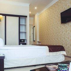 Корона отель-апартаменты комната для гостей фото 4