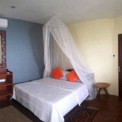 Отель Niu Ohana East Bay Apartment Филиппины, остров Боракай - отзывы, цены и фото номеров - забронировать отель Niu Ohana East Bay Apartment онлайн комната для гостей