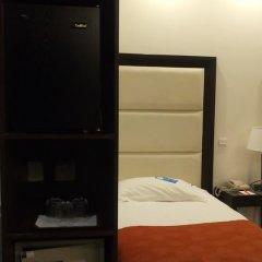 Отель Castelli сейф в номере