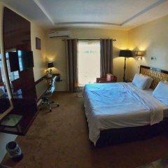 Отель Adig Suites Нигерия, Энугу - отзывы, цены и фото номеров - забронировать отель Adig Suites онлайн сейф в номере