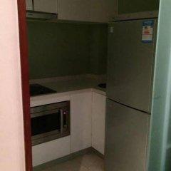 Xuanlong Apartment Hotel сейф в номере