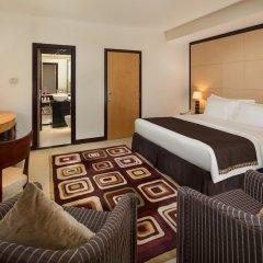 Savoy Suites Hotel Apartments комната для гостей
