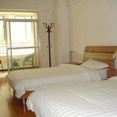 Отель Xinfu Jiayuan Short Lets Китай, Сиань - отзывы, цены и фото номеров - забронировать отель Xinfu Jiayuan Short Lets онлайн комната для гостей фото 2