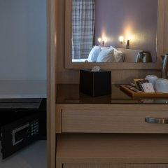 Acropolis View Hotel Афины сейф в номере
