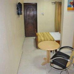 Solitude Hotel Yaba Лагос удобства в номере фото 2