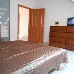 Апартаменты Apartments u Staropramenu комната для гостей фото 5