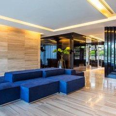 Отель Zire Wongamat Condo Pattaya By AJ Паттайя интерьер отеля