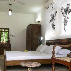 Отель Cinnamon Lake Inn комната для гостей