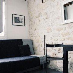 Отель Rambuteau Apartments Франция, Париж - отзывы, цены и фото номеров - забронировать отель Rambuteau Apartments онлайн комната для гостей фото 2