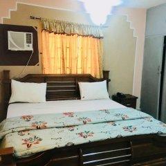 Mignonette Hotel & Suites сейф в номере