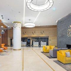 Radisson Blu Olympiyskiy Hotel интерьер отеля
