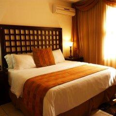 Отель La Casa De Los Arcos Сан-Педро-Сула комната для гостей фото 2