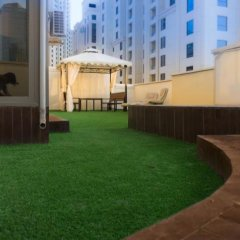 Апартаменты Dubai Beach Host Terrace Apartments бассейн