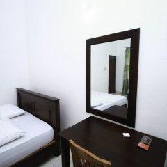 Отель Yoho Relax On Kotte сейф в номере