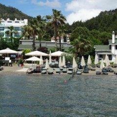 Отель Beachwood Villas пляж фото 2