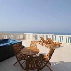 Отель Capital Coast Resort & Spa балкон
