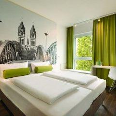 Отель Super 8 by Wyndham Dresden комната для гостей фото 3