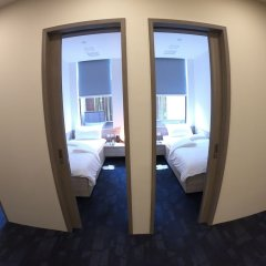 Отель JetQuay Suites Сингапур комната для гостей