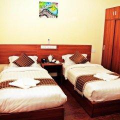 Отель City King Tourist Home Мале комната для гостей фото 2