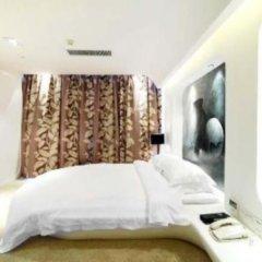 Dongguan Designer Hotel сейф в номере