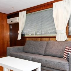 Отель Dutch Canal Boat Нидерланды, Амстердам - отзывы, цены и фото номеров - забронировать отель Dutch Canal Boat онлайн комната для гостей фото 3