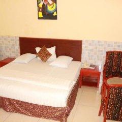 Carlcon Hotel Калабар комната для гостей фото 4